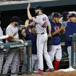 Boston Red Sox starting pitcher Chris Sale (41) high-fives teammates at the end of the eighth inning of a baseball game against the Baltimore Orioles in Baltimore, Wednesday, Sept. 20, 2017. Sale threw his 13th strikout in the eighth to become the first AL pitcher in 18 years to reach the 300 mark, and Boston won 9-0. (AP Photo/Patrick Semansky)