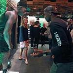 Boston, MA: September 21, 2017: Boston Celtics guard Kyrie Irving is pictured at the Celtics Nike jersey release event held at the Committee restaurant on Northern Avenue. He was having some fun trying to imitate and get a reaction from a human mannequin (left), who was posing in his new number 11 jersey at the event. (Jim Davis/Globe Staff).