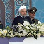 Iranian President Hassan Rouhani sits among senior army staff as he delivers his speech during the annual military parade marking the anniversary of the outbreak of its devastating 1980-1988 war with Saddam Hussein's Iraq, on September 22, 2017 in Tehran. Rouhani vowed that Iran would boost its ballistic missile capabilities despite criticism from the United States and also France. / AFP PHOTO / strSTR/AFP/Getty Images