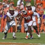 Boston College running back AJ Dillon rushes out of the backfield while pursued by Clemson's Clelin Ferrell during the first half of an NCAA college football game, Saturday, Sept. 23, 2017, in Clemson, S.C. (AP Photo/Richard Shiro)