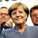 BERLIN, GERMANY - SEPTEMBER 24: German Chancellor and Christian Democrat (CDU) Angela Merkel smiles while thanking supporters at CDU headquarters at the end of the election evening following federal elections results that give the CDU 33% of the vote, giving it a first place finish, though 8.5% less than in the last election four years ago, on September 24, 2017 in Berlin, Germany. Chancellor Merkel is seeking a fourth term and coming weeks will likely be dominated by negotiations between parties over the next coalition government. The right-wing Alterniative for Germany (AfD) finished in the third place with a better-than-expected 13.2%. (Photo by Sean Gallup/Getty Images)