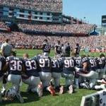 More than a dozen Patriots players either kneeled or locked arms in solidarity during the national anthem before Sunday's game against the Houston Texans. It was the Patriots' first form of public protest.