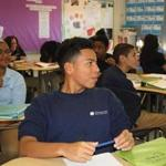 Facing page: Students in a 10th-grade humanities class at the Muniz Academy.