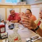 (Left to right) Bob Wiser, Bill Woolen, and Mark Zivan listened as Roger Putman shared a story while having breakfast at the Fairway Restaurant in Eastham.