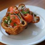 A popover with cream cheese, house cold-smoked salmon, red onion, fresh herbs and capers at NOCA Provisions.