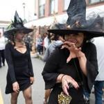 Salem, MA -- 10/08/17 -- Brittany Rose, a visitor from Orlando, walks around the street dressed as a witch during Salem Haunted Happenings, on October 8, 2017, in Salem, Massachusetts. (Kayana Szymczak for The Boston Globe)