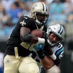 CHARLOTTE, NC - SEPTEMBER 24: Adrian Peterson #28 of the New Orleans Saints runs with the ball against Luke Kuechly #59 of the Carolina Panthers during their game at Bank of America Stadium on September 24, 2017 in Charlotte, North Carolina. (Photo by Streeter Lecka/Getty Images)