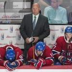 Montreal Canadiens head coach Claude Julien and players Jonathan Drouin (92), Brendan Gallagher (11) and Alex Galchenyuk (27) look on from the bench during the third period of an NHL hockey game against the Chicago Blackhawks, Tuesday, Oct. 10, 2017 in Montreal. (Graham Hughes/The Canadian Press via AP)