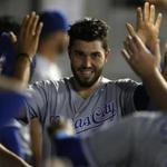 Kansas City Royals' Eric Hosmer celebrates with teammates after scoring a run against Chicago White Sox during the fourth inning of a baseball game Saturday, Sept. 23, 2017, in Chicago. (AP Photo/Jim Young)