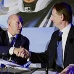Bombardier's Alain Bellemare (left) and Airbus's Romain Trapp shook hands during Monday's news conference.
