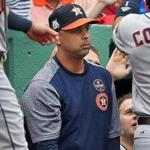 Boston, MA: October 9, 2017: Former Red Sox infielder Alex Cora (pictured) has been mentioned as a possible replacement for fired Boston manager John Farrell (not pictured). Cora, shown in the visitor's dugout at Fenway Park, is currently the bench coach for the Houston Astros. The Boston Red Sox hosted the Houston Astros in Game Four of an ALDS baseball game at Fenway Park. (Jim Davis/Globe Staff).