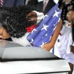 Myeshia Johnson, the wife of Army Sgt. La David Johnson, kissed her husband's casket during his funeral service at the Hollywood Memorial Gardens in Hollywood, Fla., Saturday.