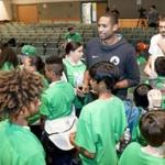 Content Folder: Regional Assignment Info: Celtics player, Al Horford,(center) participated in a community program that involves two middle schools, one from Lawrence, one from North Andover. players held a workshop around violence prevention, diversity, bullying, and bystander responses. They'll formulate a