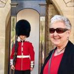 Susan Muther, the author's mom, watches the changing of the guard at Buckingham Palace.