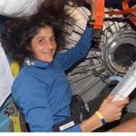 Astronaut Sunita L. Williams looked over a procedures checklist in the Quest Airlock of the International Space Station.