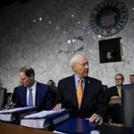 Sen. Orrin Hatch (R-Utah) chairs a Senate Finance Committee executive session on tax policy, on Capitol Hill in Washington, Nov. 15, 2017. Senate Republicans have decided to include the repeal of the Affordable Care ActÕs requirement that most people have health insurance into the sprawling tax rewrite. At left is Sen. Ron Wyden (D-Ore.), the ranking Democrat on the committee. (Eric Thayer/The New York Times)