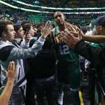 Boston, MA: 11-16-17: The Celtics Al Horford gets a lot of hands from the fans as he leaves the court following Boston's victory. The Boston Celtics hosted the Golden State Warriors in a regular season NBA basketball game at the TD Garden. (Jim Davis/Globe Staff)