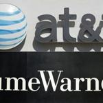 (FILES)This file combination of pictures shows an AT&T cellphone store (TOP) in Springfield, Virginia, on October 23, 2014, and the Time Warner company logo on the front of the headquarters building, 24 November, 2003 in New York. Shares of Time Warner tumbled on November 2, 2017 following a report the Justice Department could move to block the proposed $85 billion takeover of the company by AT&T. The Justice Department is considering a lawsuit to block the megadeal, but has not made a final decision, the Wall Street Journal reported. The two sides are in settlement talks with the department, but they are not close to an agreement, the report said. / AFP PHOTO / SAUL LOEB AND STAN HONDASAUL LOEB,