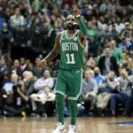 Boston Celtics' Kyrie Irving (11) celebrates sinking a basket against the Dallas Mavericks in the second half of an NBA basketball game, Monday, Nov. 20, 2017, in Dallas. (AP Photo/Tony Gutierrez)