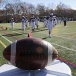 Marblehead, MA: 11-23-2017: Football waits on the sideline as Swampscott High School's football team returns too the field for second half of the Thanksgiving Day game at Marblehead High School in Marblehead, Mass., Nov.. 23, 2017. Photo/John Blanding, Boston Globe staff story/Owen Pence( 24schmarblehead )