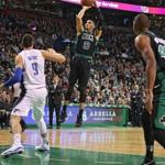 Boston MA 11/24/17 Boston Celtics Jayson Tatum pulls up for a jump shot over Orlando Magic Nikola Vecevic during first quarter NBA action at the TD Garden. (Matthew J. Lee/Globe staff) topic reporter: