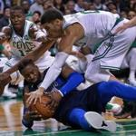 Boston, MA: 12-06-17: The Celtics Terry Rozier (left) and Jayson Tatum (right) battle with the Mavericks Wesley Matthews (center) for a fourth quarter loose ball. Tatum was whistled for a foul on the play, a call which he and the Celtics bench disputed vocally. The Boston Celtics hosted the Dallas Mavericks in a regular season NBA basketball game at the TD Garden. (Jim Davis/Globe Staff)