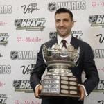 Patrice Bergeron of the Boston Bruins holds the Frank J. Selke Trophy after winning the award during the NHL Awards, Wednesday, June 21, 2017, in Las Vegas. (AP Photo/John Locher)