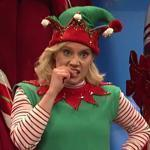 Kate McKinnon as Amy the Elf tries to help Santa, played by Kenan Thompson, answer some difficult questions from children.