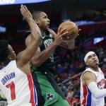 Celtics forward Al Horford split the Pistons' defense on a drive to the basket during the first half.