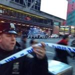 Police put up cordons near Times Square on Monday after a terrorist pipe bomb exploded in a subway tunnel under the Port Authority Bus Terminal.