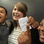 Sydney Chaffee and two of her students at Codman Academy celebrate in May 2016, when she was named Massachusetts Teacher of the Year.
