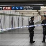 Police stood near the scene of Monday's subway attack in New York City's subway system.