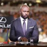 NFL analyst Marshall Faulk waits to speak during a half-time show of an NFL football game between the Cincinnati Bengals and the Houston Texans, Thursday, Sept. 14, 2017, in Cincinnati. (AP Photo/Frank Victores)