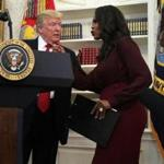 Omarosa Manigault Newman and President Trump in better days.