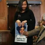 Eva Mitchell carried a photo of Lena Bruce as she arrived for the sentencing of James Witkowski at Suffolk Superior Court Thursday. Eva Mitchell was Lena Bruce's sorority sister at Delta Sigma Theta Sorority, Inc.