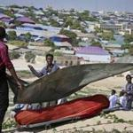 Somali men covered the body of a victim Thursday's suicide bomb attack in Mogadishu.