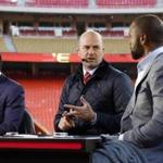 ESPN's Monday Night Football presenters from left: Randy Moss, Matt Hasselbeck and Charles Woodson are seen on the set at Arrowhead Stadium before an NFL football game between the Kansas City Chiefs and the Denver Broncos, in Kansas City, Mo., Monday, Oct. 30, 2017. (AP Photo/Colin E. Braley)
