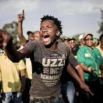 African National Congress supporters danced and sang Saturday outside the party's gathering in Johannesburg.