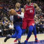 Oklahoma City Thunder's Russell Westbrook, left, drives to the basket past Philadelphia 76ers' Joel Embiid, right, of Cameroon, during the first half of an NBA basketball game, Friday, Dec. 15, 2017, in Philadelphia. (AP Photo/Chris Szagola)