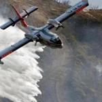 A Bombardier 415 Super Scooper dropped water on hot spots along the hillside east of Gibraltar Road in Santa Barbara, Calif., on Sunday morning.