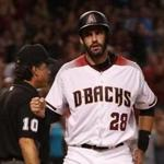 PHOENIX, AZ - SEPTEMBER 13: J.D. Martinez #28 of the Arizona Diamondbacks reacts after scoring a run against the Colorado Rockies during the fifth inning of the MLB game at Chase Field on September 13, 2017 in Phoenix, Arizona. (Photo by Christian Petersen/Getty Images)