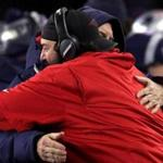 Foxborough, MA - 1/13/2018 - (4th quarter) New England Patriots head coach Bill Belichick shares an embrace with Defensive Cordinator Matt Patricia at the end of the game. The New England Patriots host the Tennessee Titans in a AFC Divisional Playoff game at Gillette Stadium in Foxborough. - (Barry Chin/Globe Staff), Section: Sports, Reporter: Ben Volin, Topic: 14Titans-Patriots, LOID: 8.4.605014565.