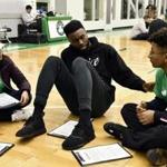 Jaylen Brown of the Celtics with Amaiya Lu and Chris Garcia at the team's practice facility on MLK Day.