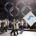 FILE - In this Feb. 10, 2006, file photo, Korea flag-bearer's Bora Lee and Jong-In Lee, carrying a unification flag lead their teams into the stadium during the 2006 Winter Olympics opening ceremony in Turin, Italy. North Korea plans to send a spotlight-stealing delegation to next month's Winter Olympics in the South Korean county of Pyeongchang. (AP Photo/Amy Sancetta, File)