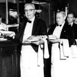 Boston, MA - 5/29/1957: From left, waiters Charles Bischoff, Pat Donovan, Ernie Kunstler and Alfred Elias pick up their plates inside Jacob Wirth Co. in Boston, May 29, 1957. (Bill O'Connor/Globe Staff) --- BGPA Reference: 180118_ON_001