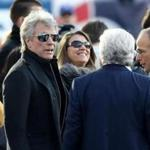 Jon Bon Jovi with Robert and Jonathan Kraft before Sunday's game.