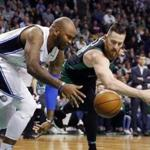 Boston Celtics' Aron Baynes, right, battles Orlando Magic's Marreese Speights for a loose ball Boston Celtics' during the first quarter of an NBA basketball game in Boston, Sunday, Jan. 21, 2018. (AP Photo/Michael Dwyer)