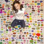 Katherine Santos, 8, of Westwood with some of the creations for her ongoing Kindness Rock Project.