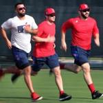 From left to right, Deven Marrero, Andrew Benintendi and Mitch Moreland sprinted around the bases at the Player Development Complex during baseball spring training on Tuesday.