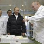 FILE - In this Monday, Sept. 20, 2010 file photo, businessman Yevgeny Prigozhin, right, shows Russian President Vladimir Putin, second right, around his factory which produces school means, outside St. Petersburg, Russia. On Friday Feb. 16, 2018, Yevgeny Prigozhin along with 12 other Russians and three Russian organizations, were charged by the U.S. government as part of a vast and wide-ranging effort to sway political opinion during the 2016 U.S. presidential election.(Alexei Druzhinin, Sputnik, Kremlin Pool Photo via AP, File)